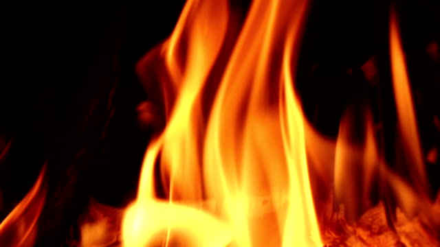 Fireplace burning. Warm cozy fire in fireplace, closeup. Slow motion video