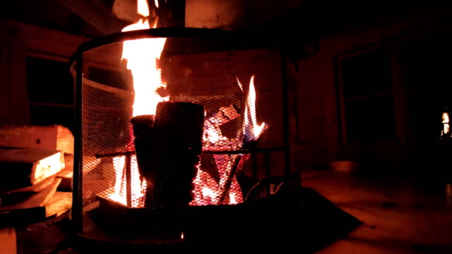 Fireplace in a forest woodent hut