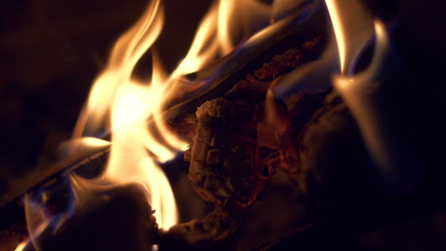Fireplace slow motion Close up of fireplace in slowmotion firewood stock videos & royalty-free footage