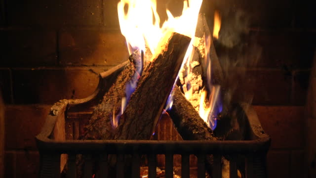 Fireplace with Burning Logs Wood logs burn in a fireplace. fireplace stock videos & royalty-free footage