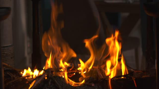 fireplace with fire burning. perfect for a romantic evening with a couple night - close-up view - romantic and warm concept - date night stock videos & royalty-free footage