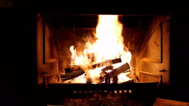 Fireplace with fire burning Fireplace with fire burning fireplace stock videos & royalty-free footage