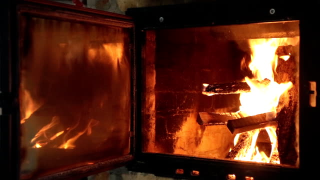 Fireplace with the door open. Burning firewood in the fireplace. Fireplace with the door open. furnace stock videos & royalty-free footage