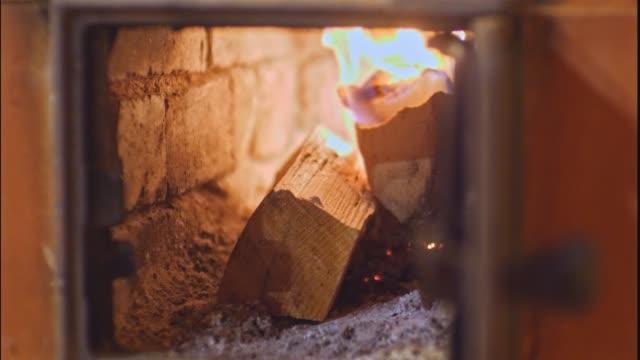 Firewood In Glass Furnace closeup