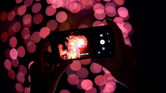 Firework and smartphone with beautiful bokeh video