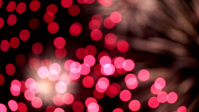 firework in blur - concept of completion of any holiday: chinese new year, new year, christmas, wedding, birthday, valentines day, thanksgiving, independence day and brazilian carnival - карнавал стоковые видео и кадры b-roll