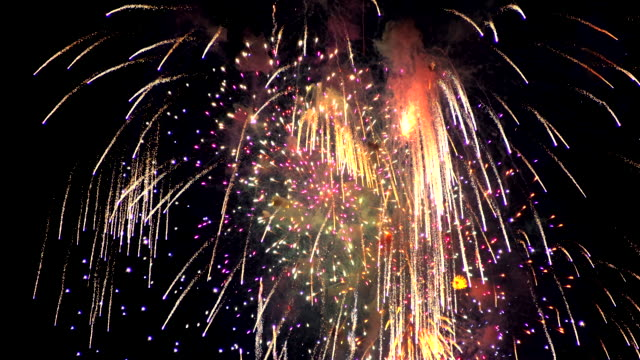 Firework in the night sky Firework in the night sky In a real celebration. happy new year 2021 stock videos & royalty-free footage