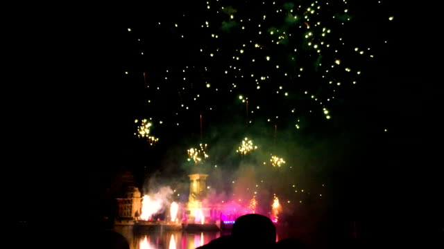 Fireworks above a lake at night at park Buen-Retiro, Madrid Fireworks above a lake at night at Madrid during San Isidro firework explosive material stock videos & royalty-free footage