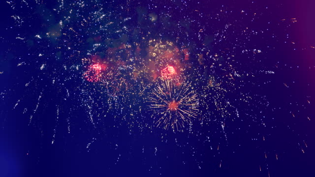 fireworks display amidst the dark sky - independence day stock videos & royalty-free footage