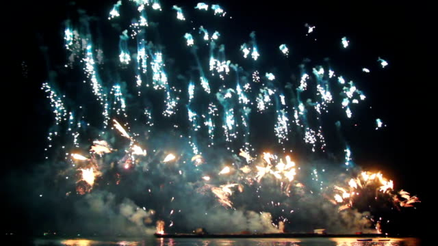 fireworks from boats on sea seamless loop video