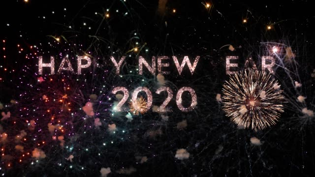fireworks on deep black sky background with happy new year 2020 greeting message, perfect for new year celebrations, typography design - event & festive concept 4k - new years stock videos & royalty-free footage