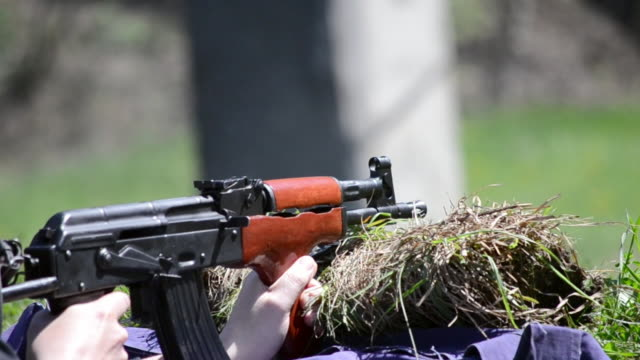 firing AK 47 tight shot video