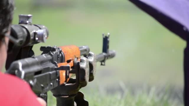 firing sniper rifle - chinese military bildbanksvideor och videomaterial från bakom kulisserna