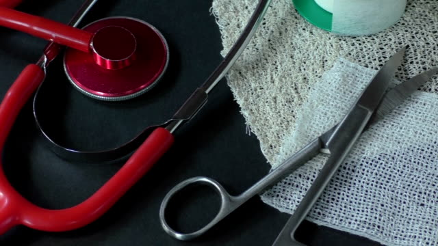 First aid kit with dressing material and red medical stethoscope video