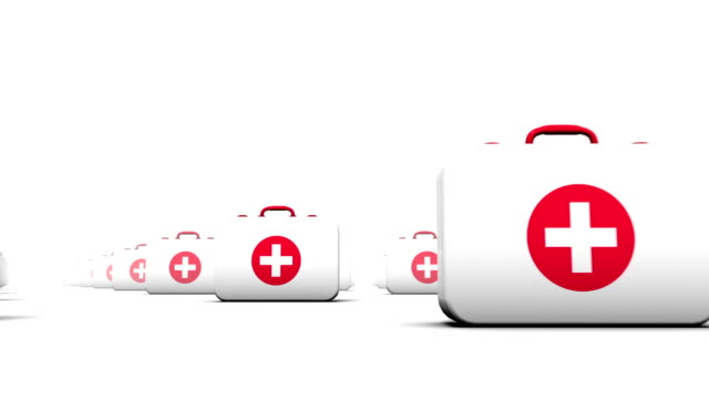 First Aid Kits low angle loop Seamless loop with camera passing endless rows looking up at First Aid Kits extending in a grid pattern to the horizon medevac stock videos & royalty-free footage