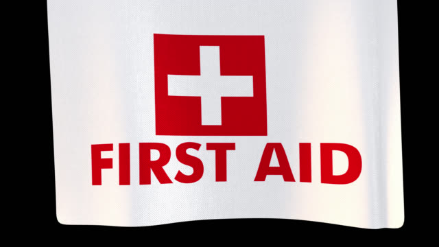 First aid unfolding cloth sign. Alpha channel will be included when downloading the 4K Apple ProRes 4444 file only