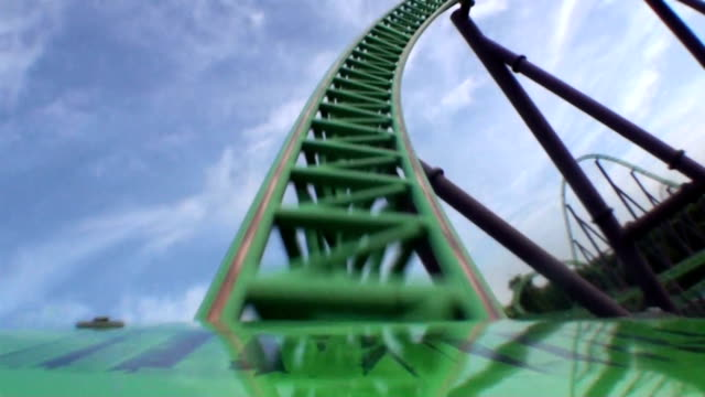first car zipping around coaster bend - luna park video stock e b–roll