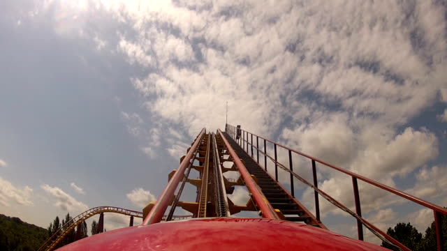 first climb up roller coaster in theme park - roller coaster stock videos & royalty-free footage