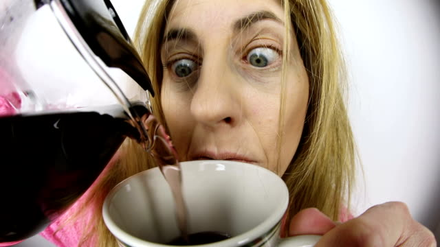 First Cup of Coffee A fisheye video clip of a woman pouring her first cup of coffee after rolling out of bed. tired stock videos & royalty-free footage