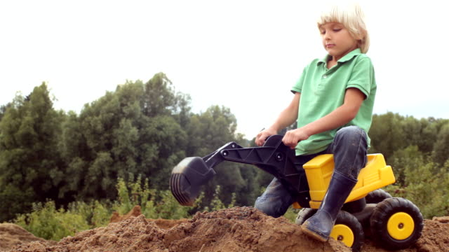 first job boy with a digger construction machinery stock videos & royalty-free footage