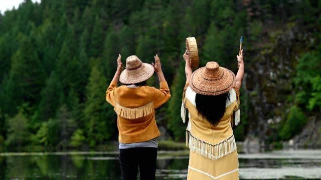 First Nations Women in Traditional Clothing Native American Women performing a welcome song. First Nations women singing. Traditional Canadian culture. generation x stock videos & royalty-free footage