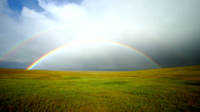 First person perspective moving towards a double rainbow First person perspective moving towards a double rainbow on the Mongolian steppe rainbow stock videos & royalty-free footage