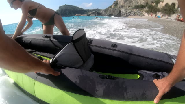 First person perspective of launching inflatable kayak