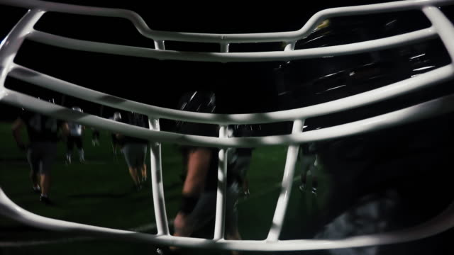 First person point of view from inside a football player's helmet, from the huddle to running a touchdown video