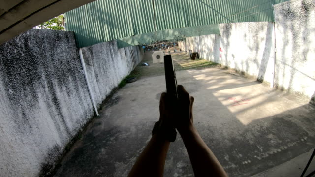 First Person Shooter PoV Shoots a 9mm Semi-Auto Pistol