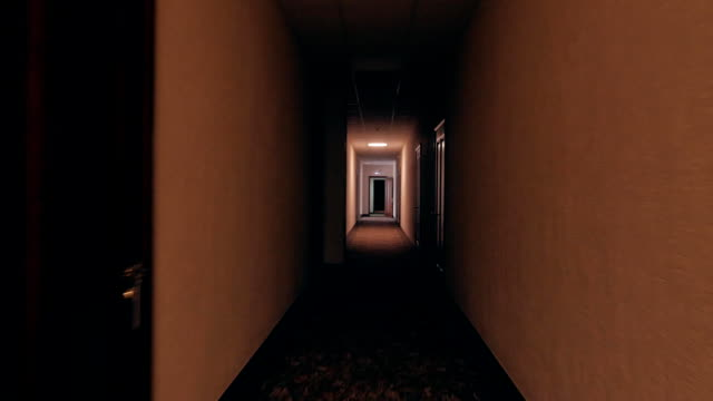 first person view, going through empty dark corridor in apartment building video