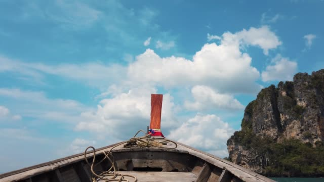 First person view of the front of the long tail boat sails in water past the cliffs First person view of the front of the long tail boat sails in water past the cliffs in Krabi in Thailand recreational boat stock videos & royalty-free footage