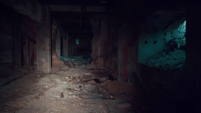 First-person view, walk with flashlight through dark creepy industrial tunnel or corridor with destruction and debris after crisis or disaster