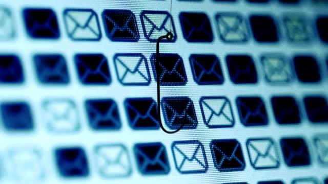 fish hook against mail bacround phishing concept - phishing filmów i materiałów b-roll