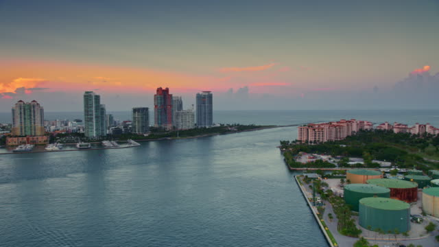 AERIAL Fisher Island and South Pointe, Miami at sunset