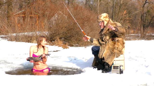 fisherman and woman in winter. - staw woda stojąca filmów i materiałów b-roll