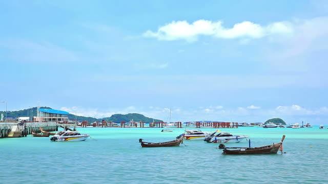 Fisherman boat  floating in Chalong Bay Beach Phuket Thailand video