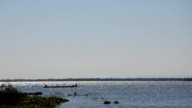 Fisherman boat in lake video