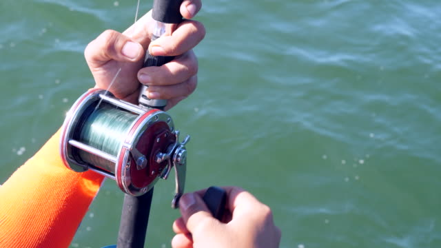 Fisherman Holding Rod with Ocean Background Fisherman Holding Rod with Ocean Background fishing rod stock videos & royalty-free footage