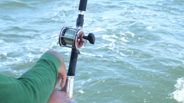 Fisherman Monitor Rod with Ocean Background Fisherman Monitor Rod with Ocean Background fishing rod stock videos & royalty-free footage