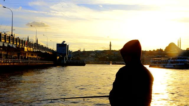 Fisherman Silhouette and the Galata Bridge