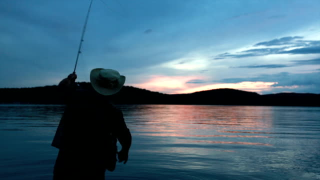 Fisherman silhouette at sunset video