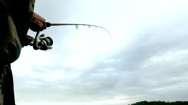 Fisherman spinning fishing reel. Fisherman on fishing Fisherman spinning fishing reel. Fisherman fishing with a fishing rod. Fisherman on fishing fishing rod stock videos & royalty-free footage