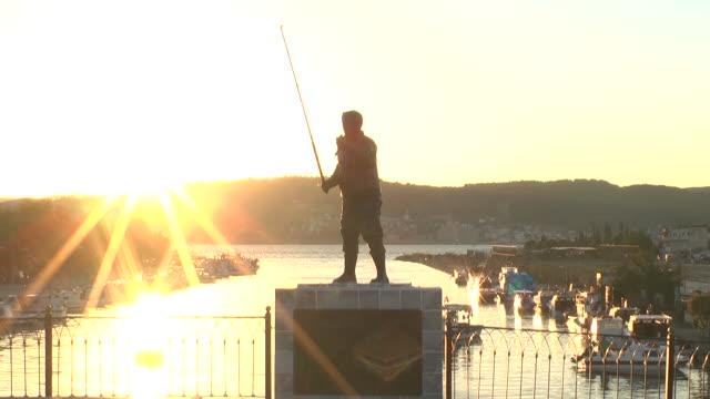 Fisherman statue on the 'inonu' bridge/Canakkale Canakkale/Turkey 09/25/2013 Fisherman statue on the 'inonu' bridge/Canakkale Canakkale/Turkey 09/25/2013 çanakkale province stock videos & royalty-free footage
