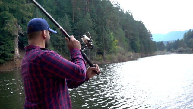 Fisherman throws fishing tackles video