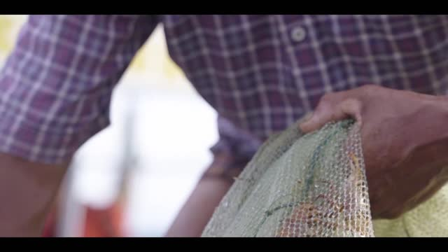 Fishermans going to set fishing net after come back from sea, Vietnam, Asia Fishermans going to set fishing net after come back from sea, Vietnam, Asia recreational boat stock videos & royalty-free footage