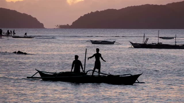 Fishermen at sunset, El Nido, Philippines video