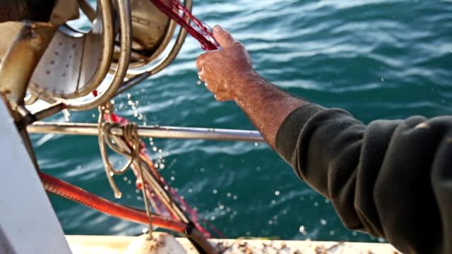 fishermen at work, pulling the nets - fiskebåt bildbanksvideor och videomaterial från bakom kulisserna