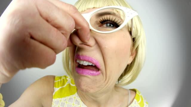 Fisheye 60's Woman Smelling Something Stinky video