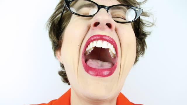 Fisheye Geeky Laughing Out Loud A 4K fisheye video clip of a geeky woman laughing out loud. mouth open stock videos & royalty-free footage