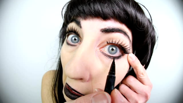 Fisheye Goth Woman Applying Eyeliner A fisheye video clip of a goth woman touching her black eyeliner. eyeliner stock videos & royalty-free footage